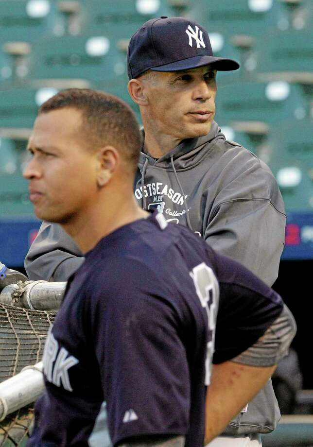 New York Yankees manager Joe Girardi, right, says the length of Alex Rodriguez's grievance hearing complicates the team's offseason planning. The players' association is trying to overturn a 211-game suspension given to the third baseman last August for alleged violations of baseball's drug program and labor contract. Girardi said Thursday that if a decision isn't made soon, the team will have to make backup third base plans in case Rodriguez isn't available. Photo: Patrick Semansky — The Associated Press  / AP