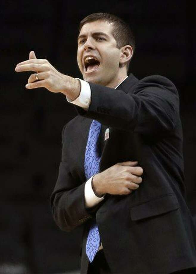 FILE - In this March 14, 2013, file photo, Butler coach Brad Stevens talks to players during an NCAA college basketball game against Dayton at the Atlantic 10 Conference tournament in New York. The Boston Celtics announced Wednesday, July 3, 2013, that Stevens has been hired as the NBA basketball team's coach, replacing Doc Rivers, who was traded to the Los Angeles Clippers. (AP Photo/Seth Wenig, File) Photo: AP / AP