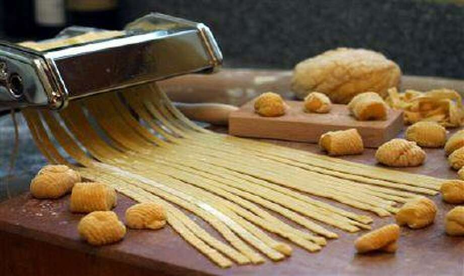 It's been much more efficient to make pasta in large factories and distribute it dried than to make it batch-by-batch in thousands of different restaurants, but could a new invention change all that? Photo: ASSOCIATED PRESS / AP2005