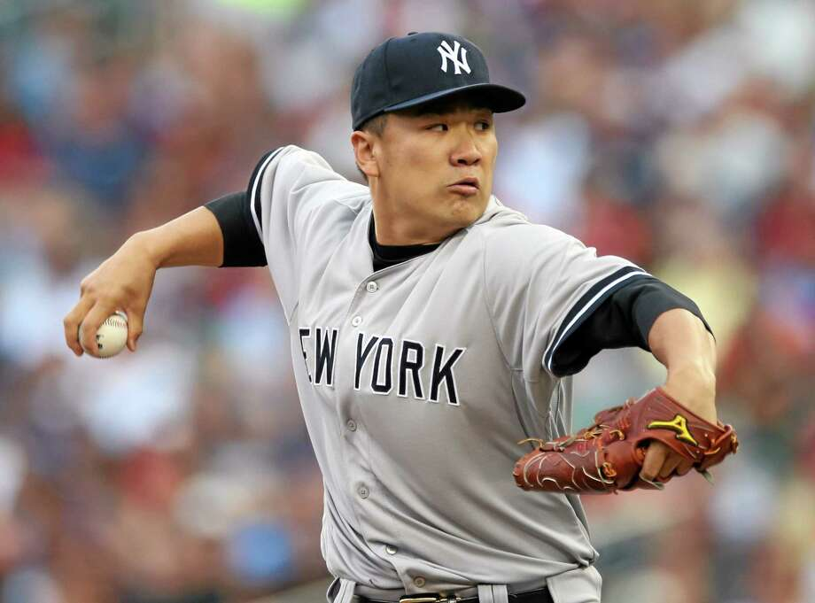 New York Yankees pitcher Masahiro Tanaka has a partially torn ligament in his right elbow. Photo: Jim Mone — The Associated Press  / AP