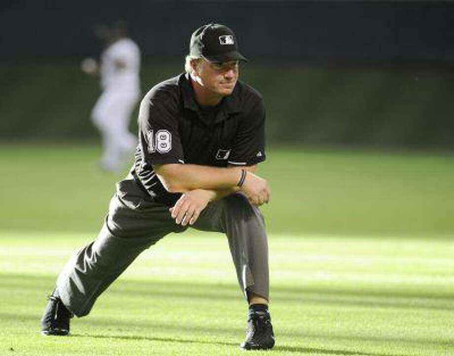 In this May 27, 2011 file photo, Major League Baseball umpire Brian Runge stretches before a baseball game between the Houston Astros and the Arizona Diamondbacks in Houston. Photo: AP / AP