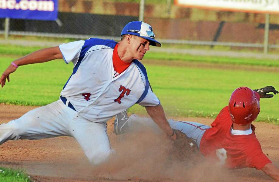 Torrington's John McCarthy stretches to tag out Wolcott's Austin Casagrande, trying to steal second base in Torrington's 9-0 win. Photo: Pete Paguaga — Register Citizen