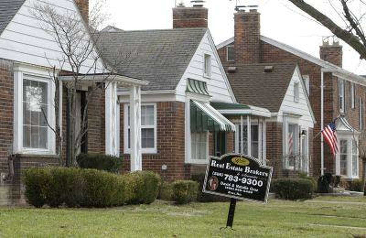 A house for sale in Detroit, Mich. (AP Photo/ Paul Sancya)