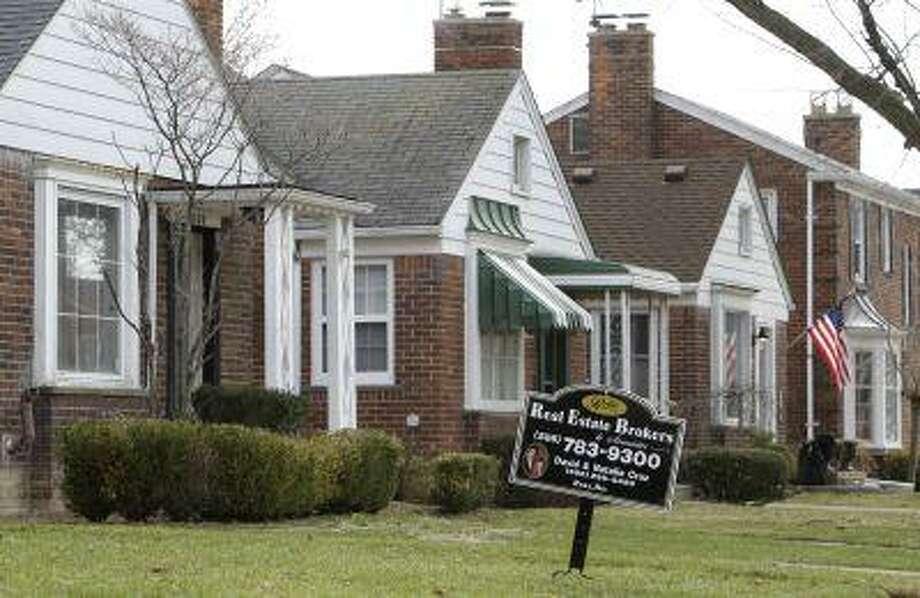 A house for sale in Detroit, Mich. (AP Photo/ Paul Sancya) Photo: ASSOCIATED PRESS / AP2011