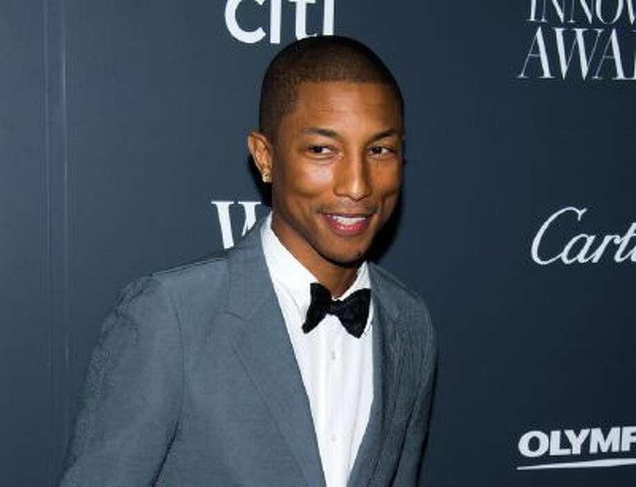 In this Nov. 6, 2013 photo, Pharrell Williams attends the WSJ. Magazine's Innovator Awards in New York.