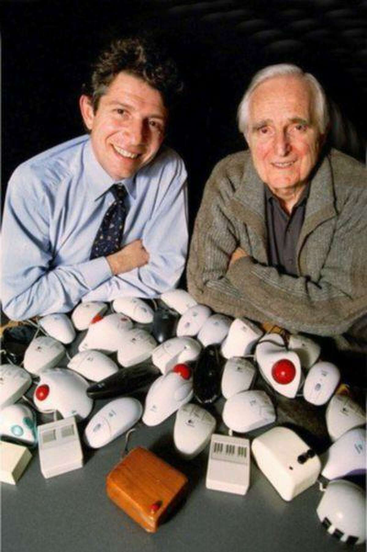 SO.Mouse30th.1207.HODoug Engelbart (right), inventoer of the computer mouse and Guerrino De Luca, president and CEO of Logitech, the world's largest mouse manufacturer, with the original wooden mouse and an array of newer versions of the mouse. The computer mouse celebrates its 30th birthday on 12/9/98.Photo/Art by:Handout