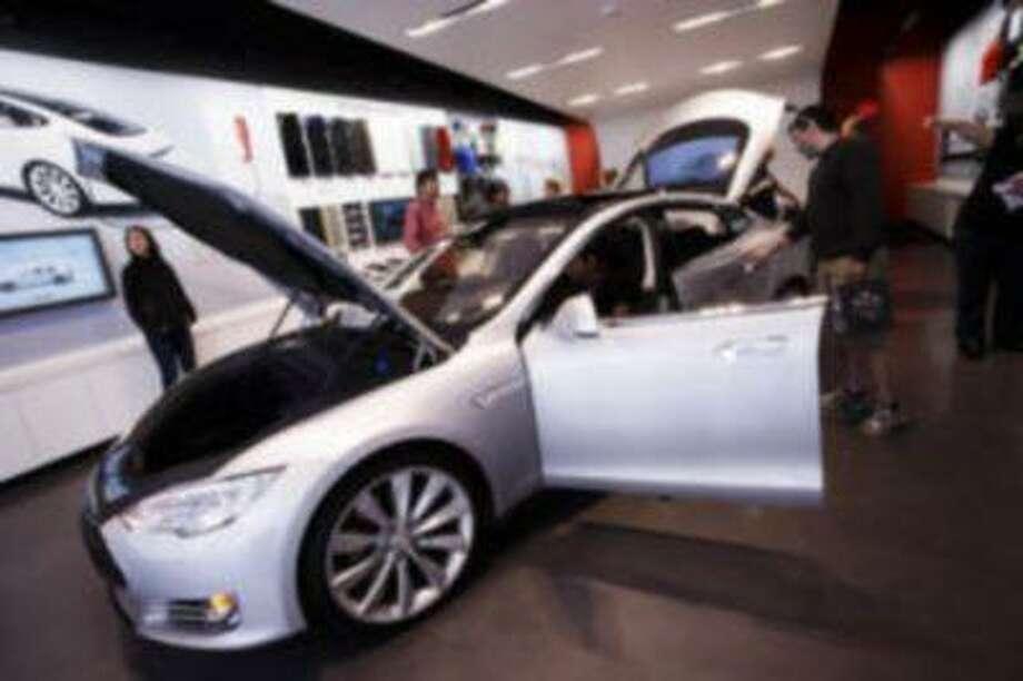 Visitors examine Tesla's Model S on April 1, 2013 at Tesla's showroom in Santana Row in San Jose. Photo: Dai Sugano/Staff / Dai Sugano/Staff