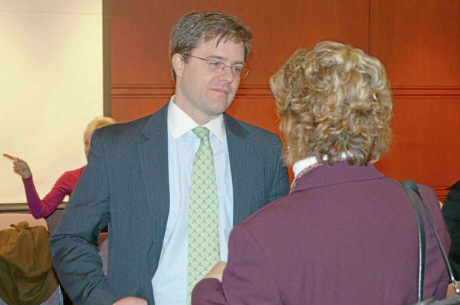 State Sen. Jason Welch, R-Bristol, speaks with a constituent in Hartford. Photo: Contributed Photo