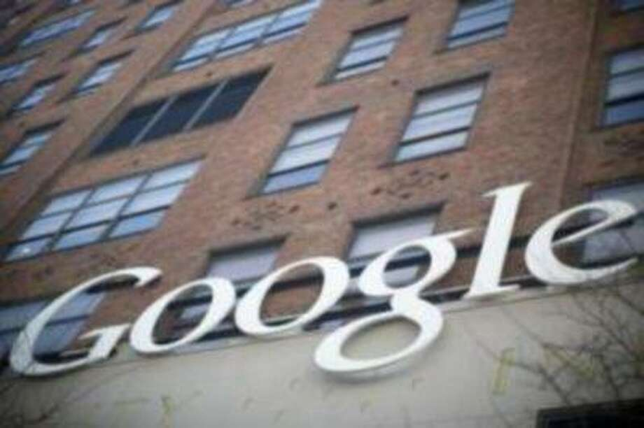 The Google signage is seen at the company's headquarters in New York January 8, 2013. REUTERS/Andrew Kelly / X02844