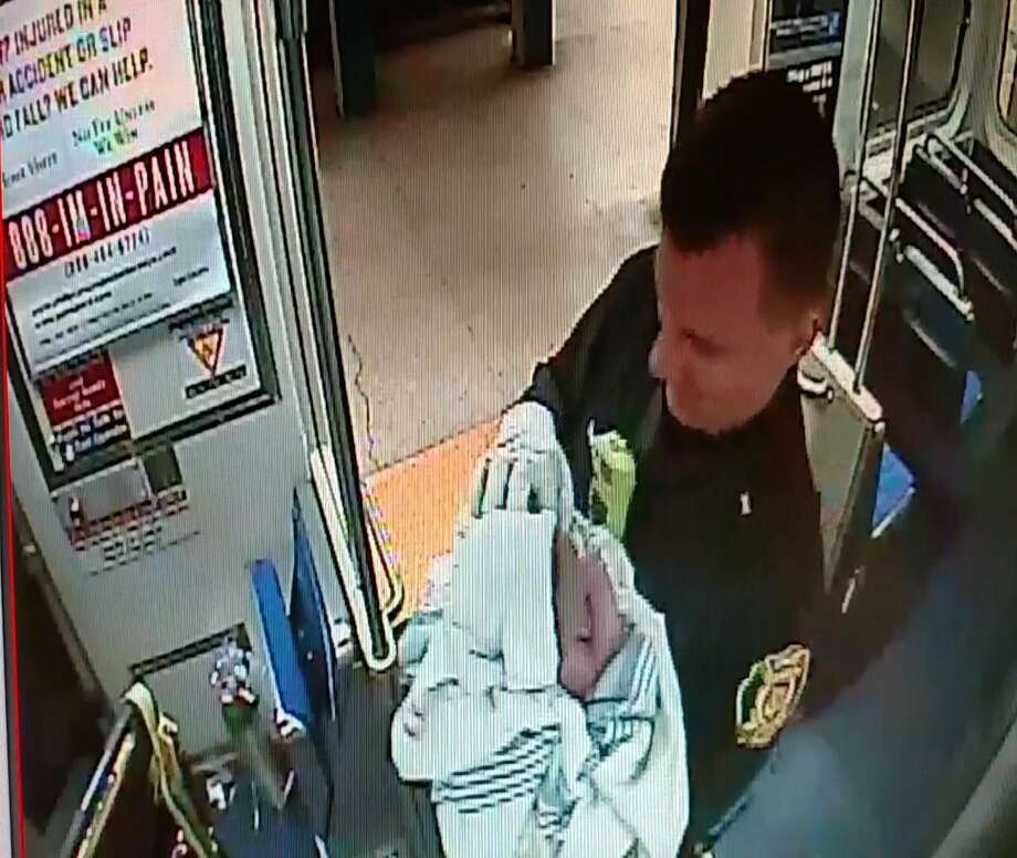 In this image from surveillance video provided by the Southeastern Pennsylvania Transportation Authority (SEPTA), Philadelphia transit police Sgt. Daniel Caban holds a baby boy he helped deliver aboard a subway train at the 15th and Market streets station in Philadelphia Thursday. The mother and newborn were taken to Hahnemann University Hospital, where they were reported in good condition. Photo: Associated Press  / SEPTA