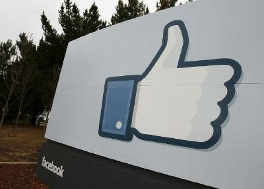 A sign with the 'like' symbol stands in front of the Facebook headquarters on Feb. 1, 2012 in Menlo Park, California.