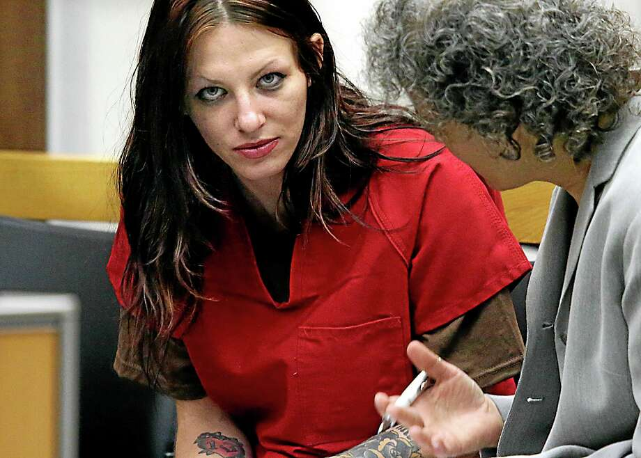 Alix Tichelman, left, 26, of Folsom, Calif., confers with public defender Diane August, right, during her arraignment in Santa Cruz Superior Court Wednesday, July 9, 2014, in Santa Cruz, Calif. Tichelman is facing manslaughter charges for the November 2013 death of Forrest Hayes, a Google executive. A Silicon Valley success story turned sordid this week with the arrest of an upscale prostitute who allegedly left Hayes dying on his yacht after shooting him up with a deadly hit of heroin. Hayes, 51, was found dead by the captain of his 50-foot yacht Escape. (AP Photo/Santa Cruz Sentinel, Shmuel Thaler) Photo: AP / Santa Cruz Sentinel