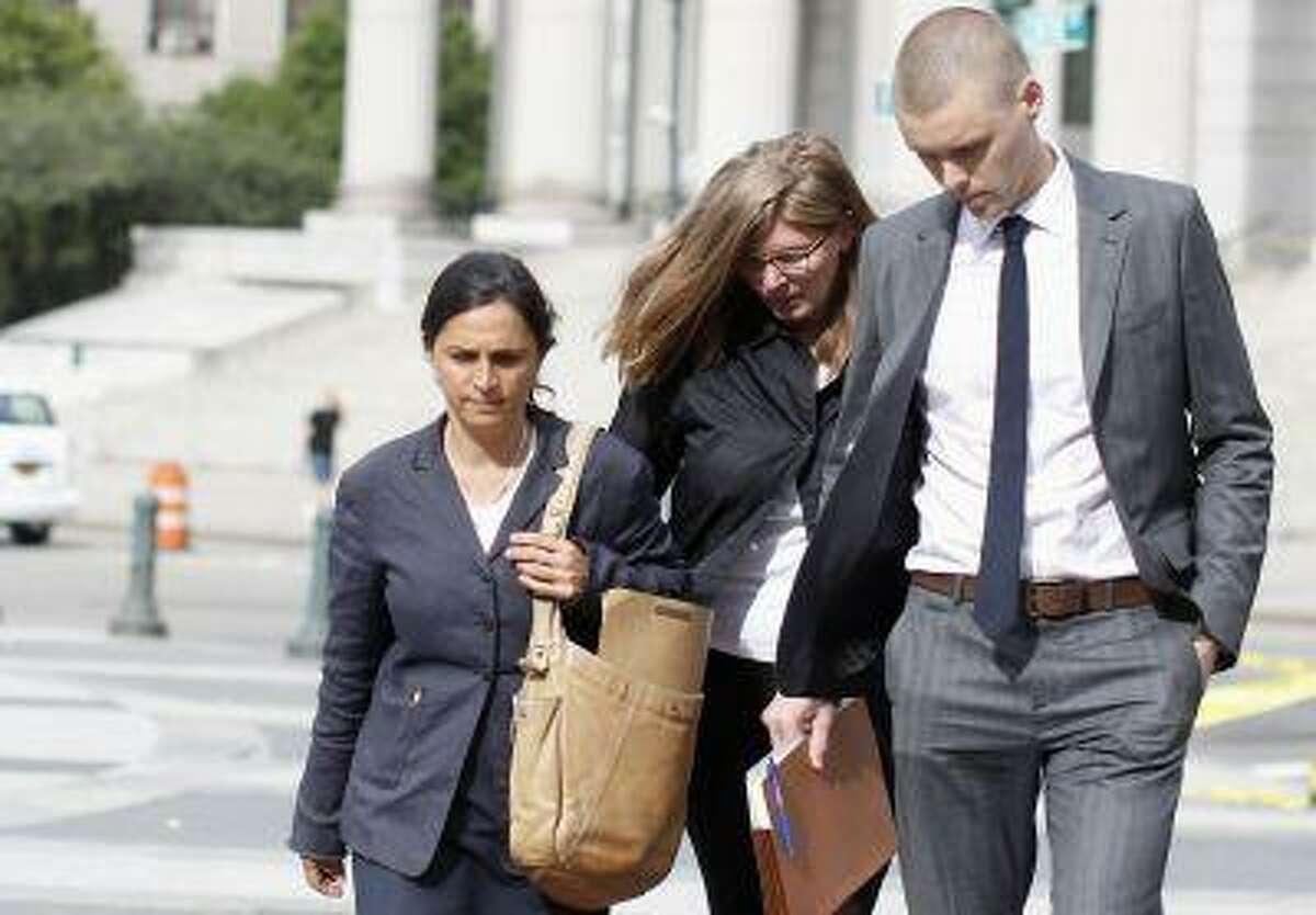 Ingrid Lederhaas-Okun (C) departs Manhattan Federal Court with her lawyer in New York, July 2, 2013. (Brendan McDermid/Reuters)