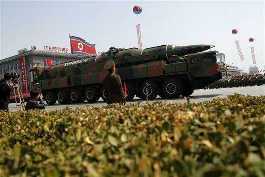 """FILE - In this Sunday, April 15, 2012 file photo, a North Korean vehicle carrying what appears to be a new missile passes by during a mass military parade in Pyongyang's Kim Il Sung Square to celebrate the centenary of the birth of the late North Korean founder Kim Il Sung. North Korea has moved a missile with """"considerable range"""" to its east coast, South Korean Defense Minister Kim Kwan-jin said Thursday, April 4, 2013 but he added that there are no signs that Pyongyang is preparing for a full-scale conflict. The report came hours after North Korea's military warned that it has been authorized to attack the U.S. using """"smaller, lighter and diversified"""" nuclear weapons. It was the North's latest war cry against America in recent weeks, with the added suggestion that it had improved its nuclear technology. (AP Photo/Ng Han Guan, File) Photo: AP / AP"""