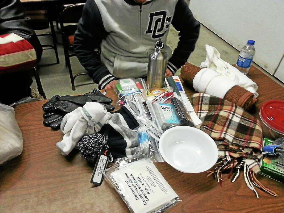 Contents of one of the Compassion Kits as a recipient goes through the kit. Photo: Submitted Photo