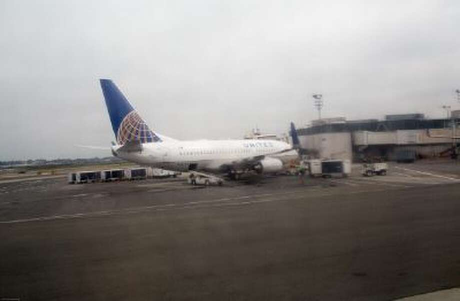 An United Airlines plane is docked at a terminal October 5, 2013 at LaGuardia Airport in the Queens borough of New York. / 2013 Robert Nickelsberg