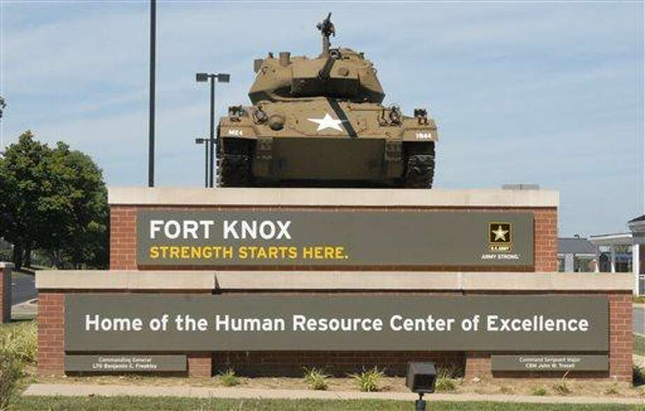 This Aug. 18, 2010 image provided by the U.S. Army shows the Chaffee Gate entrance to Fort Knox. An Army civilian employee was shot and killed in a parking lot at Kentucky's Fort Knox on Wednesday, and investigators were seeking to question a man in connection with the shooting, authorities said. Army officials said in a news release late Wednesday April 3, 2013 that the victim was an employee of the U.S. Army Human Resources Command, which handles personnel actions for soldiers. The shooting occurred in a lot outside the command. The victim was transported to the Ireland Army Community Hospital where he was pronounced dead. (AP Photo/US Army) Photo: ASSOCIATED PRESS / AP2010