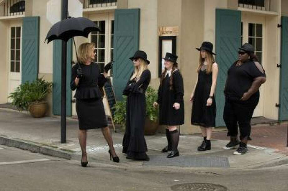 AMERICAN HORROR STORY: COVEN Pictured: (L-R): Jessica Lange as Fiona, Emma Roberts as Madison, Jamie Brewer as Nan, Taissa Farmiga as Zoe, Gabourey Sidibe as Queenie -- CR.