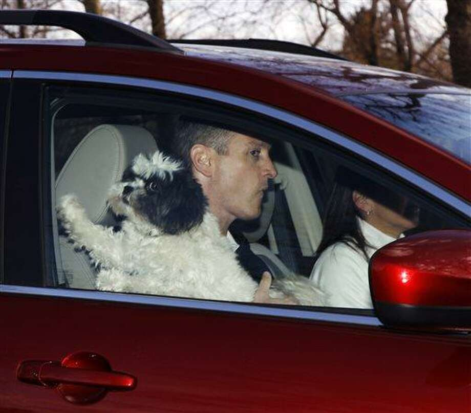 Former Rutgers head coach Mike Rice is driven from his home, Wednesday, April 3, 2013, in Little Silver, N.J. With political and social pressure mounting after video showed Rice screaming gay slurs and shoving, kicking and throwing balls at his NCAA college basketball players, the university fired Rice on Wednesday, and then did their best to avoid the blame for not getting it right four months ago. (AP Photo/Mel Evans) Photo: AP / AP