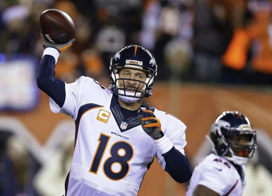 Broncos quarterback Peyton Manning throws during the first half of a recent game. Photo: The Associated Press File Photo  / AP