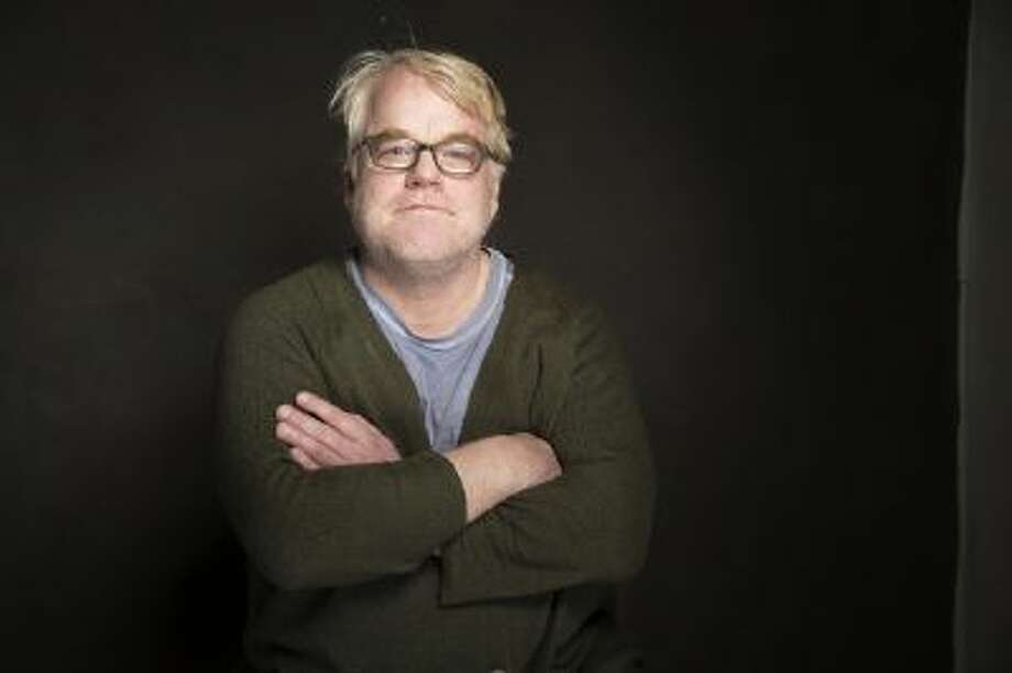 """In a Jan. 19, 2014 photo Phillip Seymour Hoffman poses for a portrait at The Collective and Gibson Lounge Powered by CEG, during the Sundance Film Festival in Park City, Utah. Hoffman, who won the Oscar for best actor in 2006 for his portrayal of writer Truman Capote in """"Capote"""" was found dead Sunday in his apartment in New York with what law enforcement officials said was a syringe in his arm. He was 46."""