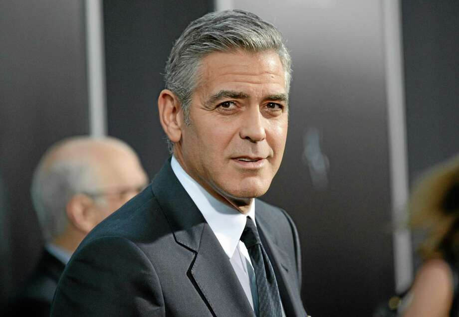 "FILE - In this Oct. 1, 2013 file photo actor George Clooney attends the premiere of ""Gravity"" at the AMC Lincoln Square Theaters, in New York. George Clooney has chastised a British newspaper over an article claiming his fiancee's mother disapproves of the impending marriage for religious reasons. Clooney said that the claims about his future mother-in-law Baria Alamuddin were untrue and irresponsible. (Photo by Evan Agostini/Invision/AP, File) Photo: Evan Agostini/Invision/AP / Invision"