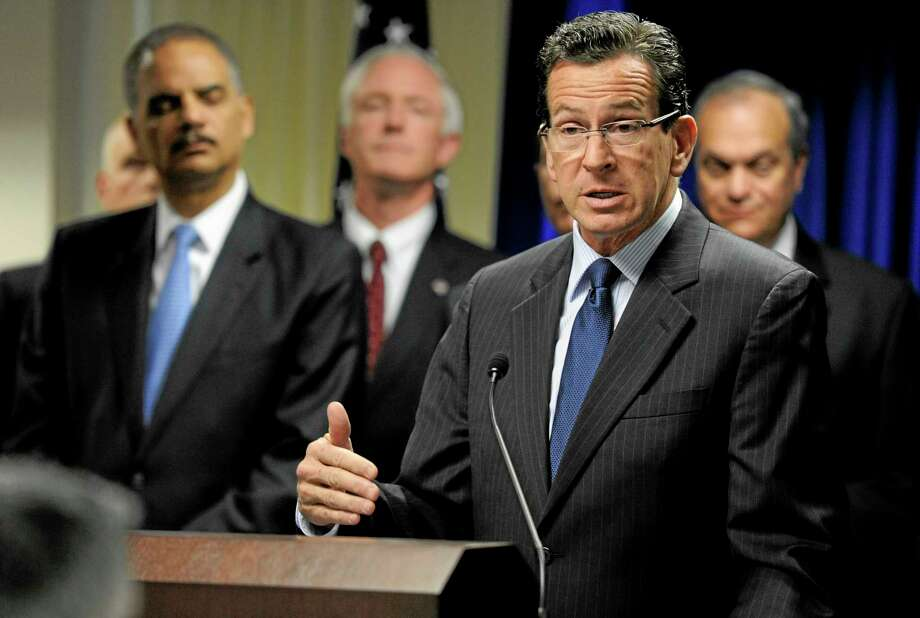 Connecticut Gov. Dannel P. Malloy gestures as he speaks at a news conference to announce a new effort to reduce gun violence in the state's major cities in New Haven, Conn., Tuesday, Nov. 27, 2012.  (AP Photo/Jessica Hill) Photo: AP / FR125654 AP