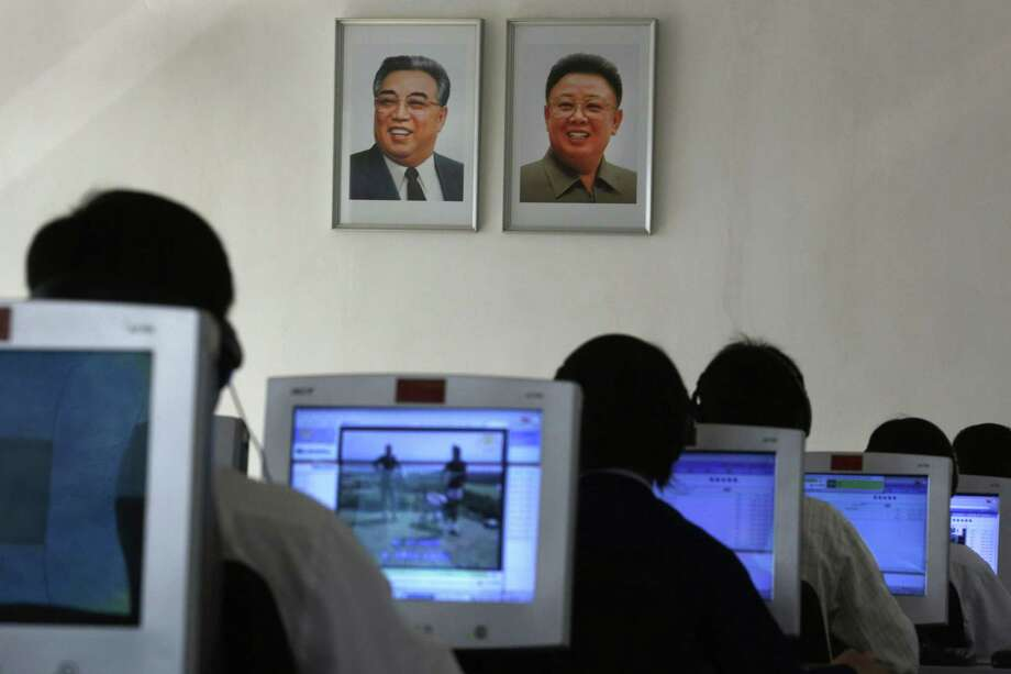 In this Sept. 20, 2012 photo, North Korean students use computers in a classroom with portraits of the country's later leaders Kim Il Sung, left, and his son Kim Jong Il hanging on the wall at the Kim Chaek University of Technology in Pyongyang, North Korea. Key North Korean websites were back online Dec. 23, 2014 after an hours-long shutdown that followed a U.S. vow to respond to a cyberattack on Sony Pictures that Washington blames on Pyongyang. Photo: AP Photo/Vincent Yu, File  / AP