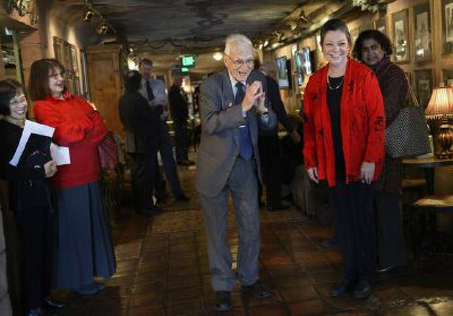 Lennox Tierney bows as he greets the KOTO musicians, Hatumi Bryant and Kimiko Osterloh as he enters his 100th birthday party. Cathy Edens, right, a former student of his, organized the party. Tierney, now 100 years old, was part of the effort to preserve Japanse art during Douglas McArthur's occupation in WWII. Friends and family held a birthday party for him at LaCaille, Sunday, Jan. 26, 2014. Photo: Scott Sommerdorf / The Salt Lake Tribune 2014