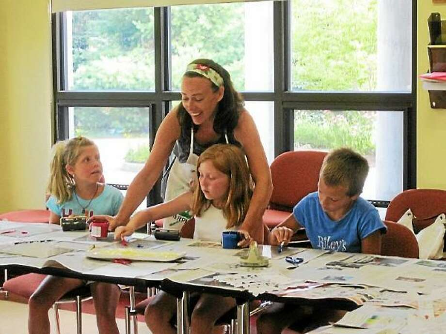 Contributed Photo Children taking part in arts and crafts during last year's Summerfest. Submitted photo.