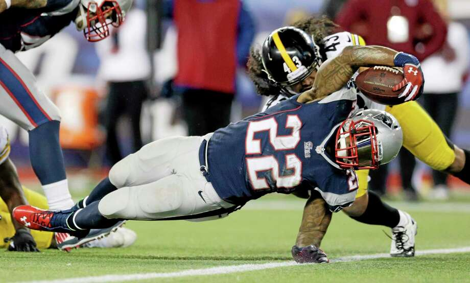 New England Patriots running back Stevan Ridley scores a touchdown in front of Pittsburgh Steelers strong safety Troy Polamalu in the fourth quarter of Sunday's game in Foxborough, Mass. Photo: Charles Krupa — The Associated Press  / AP