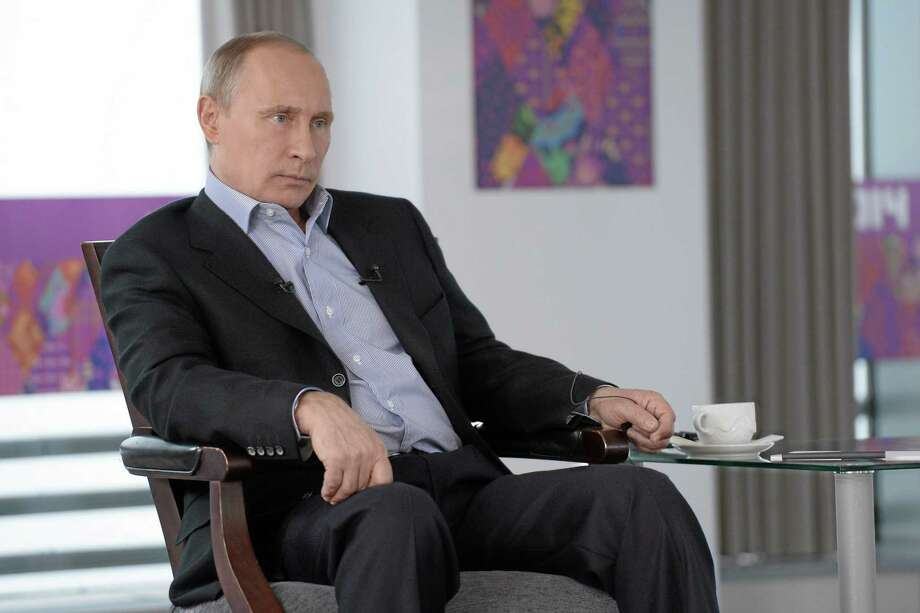 In this Friday, Jan. 17, 2014 photo made available by Presidential Press Service on Sunday, Jan. 19, 2014, Russian President Vladimir Putin listens to a translation during an interview to Russian and foreign media at the Russian Black Sea resort of Sochi, which will host Winter Olympic Games on Feb. 7, 2014. President Vladimir Putin once again has offered assurances to gays planning to attend the Sochi Olympics, but his arguments defending Russiaís ban on homosexual 'propaganda' to minors show the vast gulf between how he understands the issues and how homosexuality is generally viewed in the West. In an interview with Russian and foreign television stations broadcast Sunday, Putin equated gays with pedophiles and spoke of the need for Russia to ìcleanseî itself of homosexuality as part of efforts to increase the birth rate. Photo: (AP Photo/RIA Novosti, Alexei Nikolsky, Presidential Press Service) / RIA Novosti Kremlin