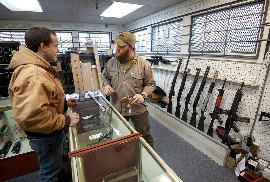 Shane Farren, of Ashby Arms, talks with customer Daniel Suter, of Harrisonburg, about stock options for his competition rifle on Wednesday at the Harrisonburg, Va., Gun Shop, Dec. 17. Virginia Governor Terry McAuliffe has proposed new gun control measures, one of which would bring back the one gun a month restriction. Photo: File Photo  / Daily News-Record