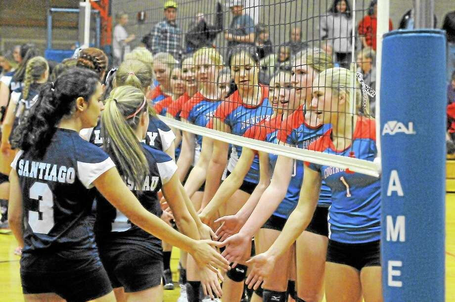 Coginchaug and Wolcott Tech shake hands after the Blue Devils defeated the Wildcats 3-0 in the second round of the Class S State Tournament. Photo: Laurie Gaboardi — Register Citizen