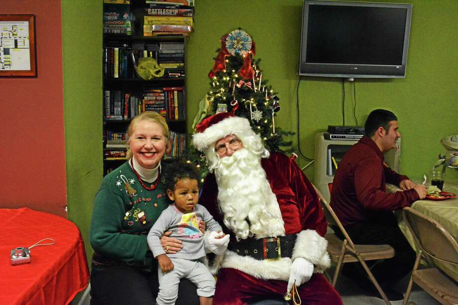 AMANDA WEBSTER — REGISTER CITIZEN FISH clients and guests were treated to a visit from Santa Claus during its annual Christmas party Dec. 23. The organization helps people who are homeless and jobless get back on their feet, with plenty of support from the local community. Photo: Journal Register Co.