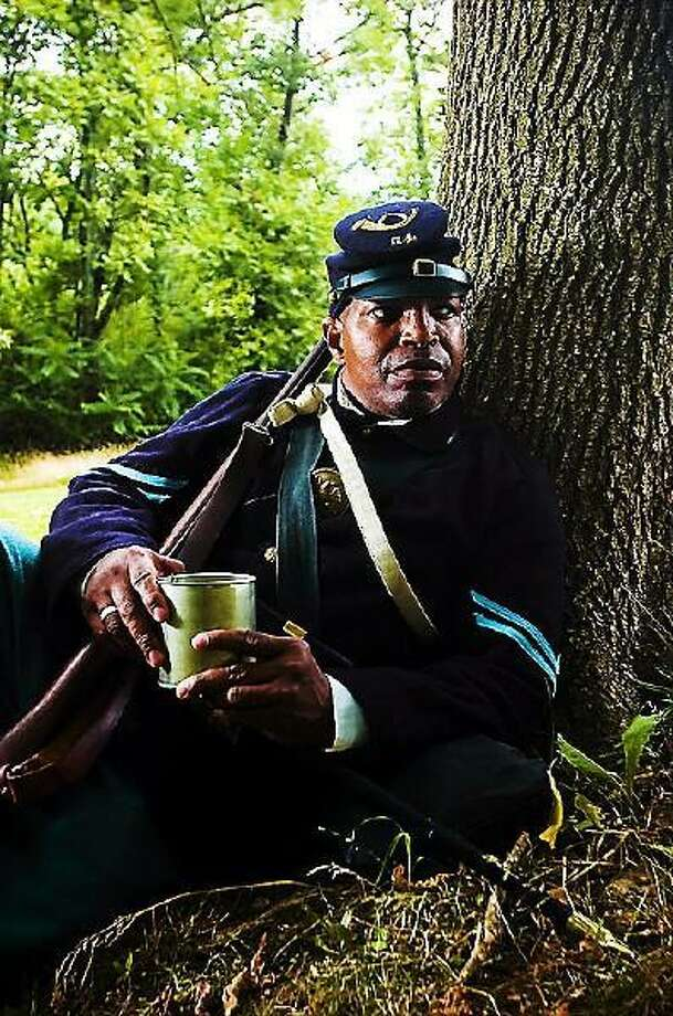 NEWS THE EVENING SUN -- SHANE DUNLAP Reggie Thomas, of Gettysburg, is a re-enactor who is part of the 54th Massachusetts Volunteer Infantry. Photo: Shane Dunlap - The Evening Sun / Shane Dunlap - The Evening Sun - Digital First Media