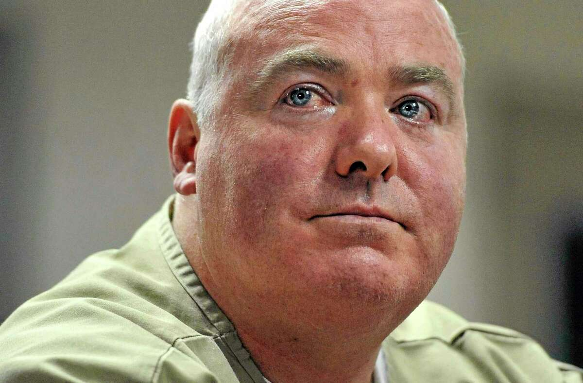 FILE - In this Wednesday, Oct. 24, 2012, file photo, Michael Skakel listens during a parole hearing at McDougall-Walker Correctional Institution in Suffield, Conn. A Connecticut judge is hearing arguments on whether he has the authority to release Kennedy cousin Skakel from prison while he awaits a new trial in the 1975 slaying of neighbor Martha Moxley. (AP Photo/Jessica Hill, Pool, File)
