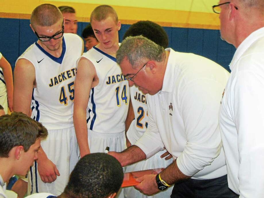 Gilbert coach Mark Douglass talks strategy with his team. Photo: Peter Wallace — The Register Citizen