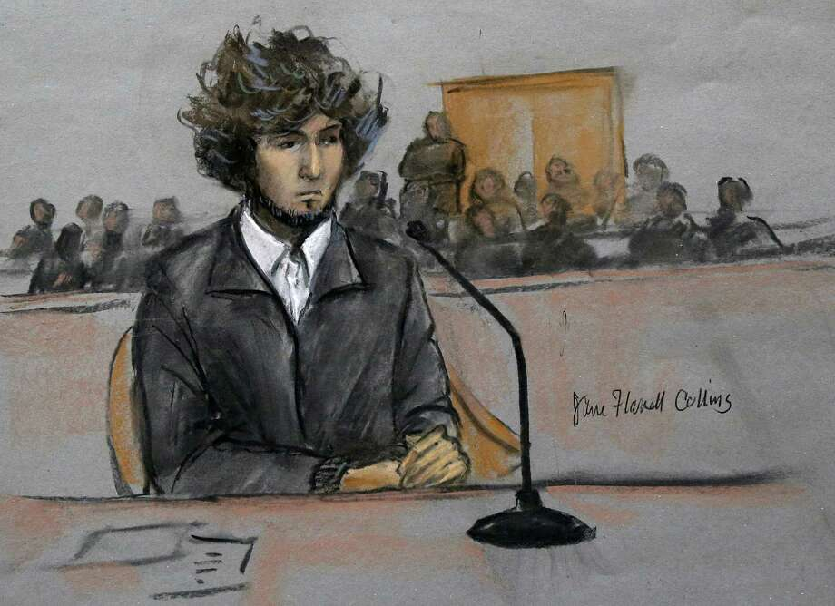 In this courtroom sketch, Boston Marathon bombing suspect Dzhokhar Tsarnaev is depicted sitting in federal court in Boston Thursday, Dec. 18, 2014, for a final hearing before his trial begins in January. Tsarnaev is charged with the April 2013 attack that killed three people and injured more than 260. He could face the death penalty if convicted.  (AP Photo/Jane Flavell Collins) Photo: AP / Jane Flavell Collins