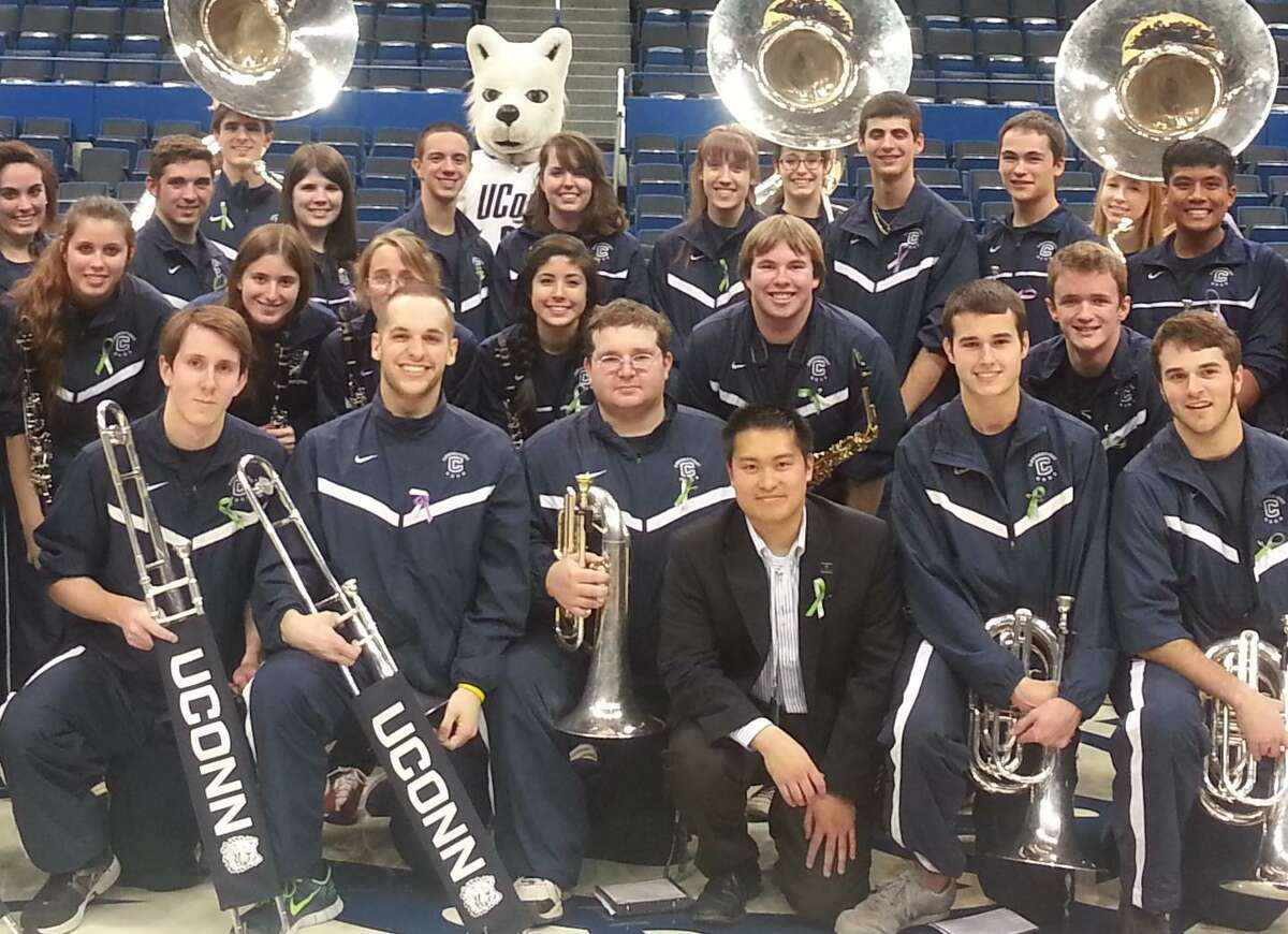 Submitted photo. Justin McManus, in black, who currently leads the UConn pep band as a graduate assistant, will begin working as an assistant band director at Notre Dame this summer.