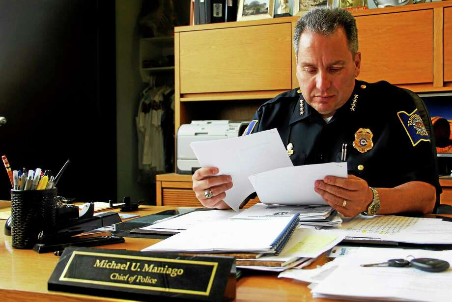 Torrington Police Chief Michael Maniago sits at his desk Tuesday. Maniago has been tasked with finding $26,000 to cut from his department's budget for the 2014-15 fiscal year. Photo: Esteban L. Hernandez — The Register Citizen