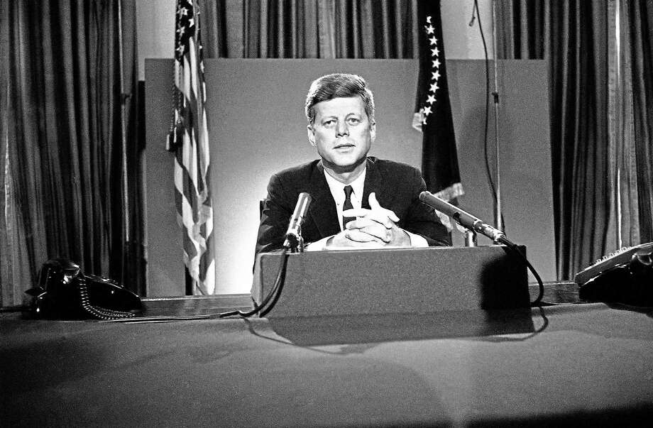 FILE - In this July 26, 1963 file photo, U.S. President John F. Kennedy sits behind microphones at his desk in Washington after finishing his radio-television broadcast to the nation on the nuclear test ban agreement initialed by negotiators in Moscow. (AP Photo/John Rous) Photo: AP / AP