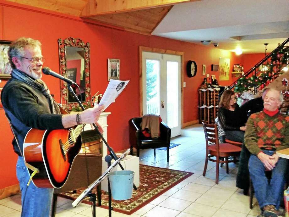 Photos by N.F. Ambery Local musician Bill Benson smiles during his musical performance at Miranda Vineyard in Goshen on Sunday. Photo: Journal Register Co.
