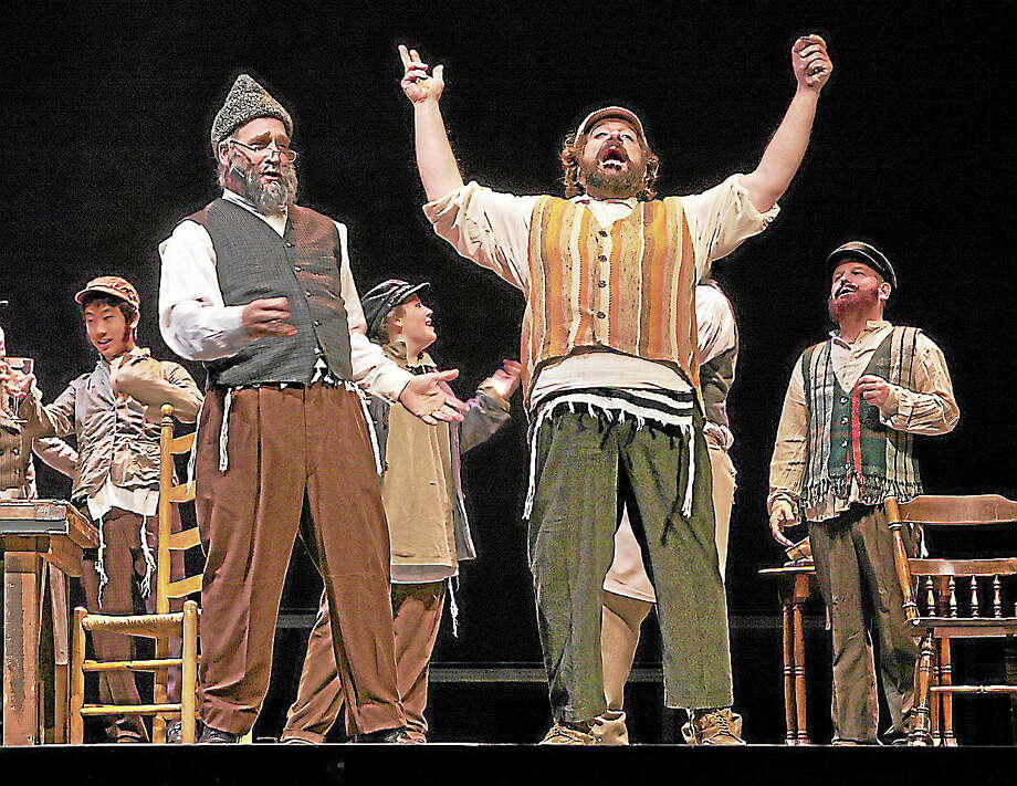 "Photos by Sharon WilcoxCast members rehearse a scene from ""Fiddler on the Roof"" which is being performed at the Warner Theatre in Torrington. Photo: Journal Register Co."