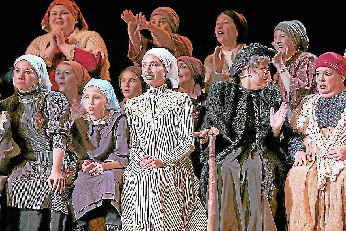 """Photos by Sharon WilcoxCast members rehearse a scene from """"Fiddler on the Roof"""" which is being performed at the Warner Theatre in Torrington."""