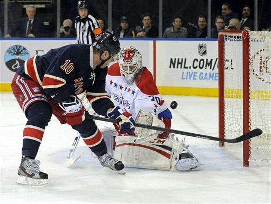 Washington Capitals goaltender Braden Holtby, right, makes a save on a shot by New York Rangers' Marian Gaborik, of Slovakia, during the second period of an NHL hockey game Sunday, March 24, 2013, at Madison Square Garden in New York.  (AP Photo/Bill Kostroun) Photo: ASSOCIATED PRESS / AP2013