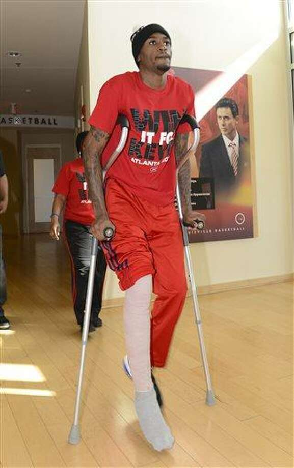 Louisville basketball player Kevin Ware arrives for an interview Wednesday April 3, 2013, at the KFC Yum! Center practice facility in Louisville, Ky. Ware was released from an Indianapolis hospital Tuesday, two days after millions watched him break his right leg on a horrifying play trying to block a shot during an NCAA college basketball regional championship game against Duke.  (AP Photo/Timothy D. Easley) Photo: ASSOCIATED PRESS / AP2013