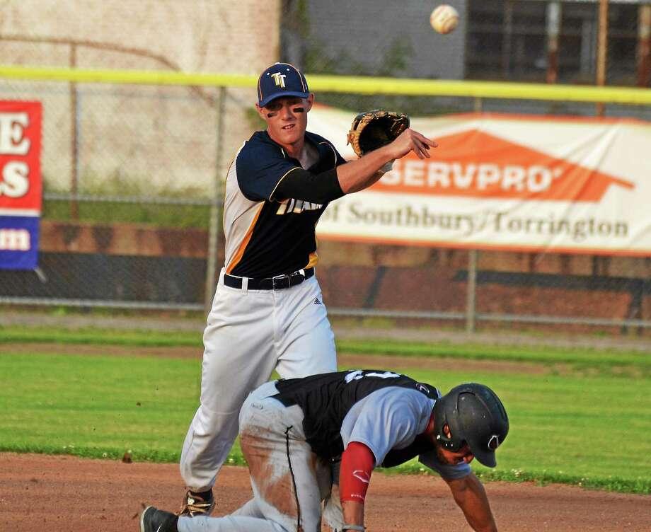 Torrington Titans second baseman Kyle Decker turns a double play. Photo: Pete Paguaga — Register Citizen