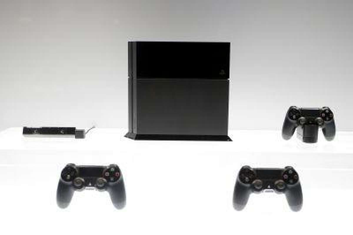 The new PlayStation 4 is on display at the Sony booth during the E3 game show in Los Angeles, Tuesday, June 11, 2013. (AP Photo/Jae C. Hong)