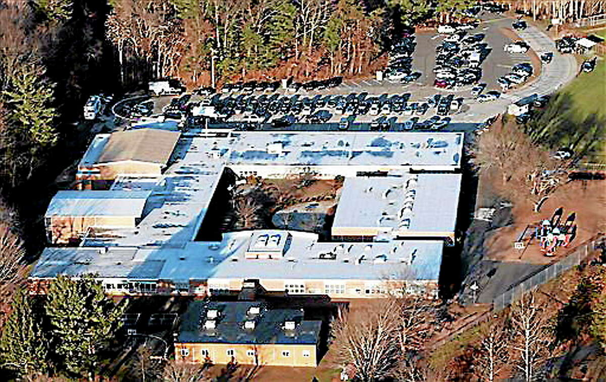 This aerial file photo shows Sandy Hook Elementary School in Newtown as it was Dec. 14, 2012, the day of the shootings.